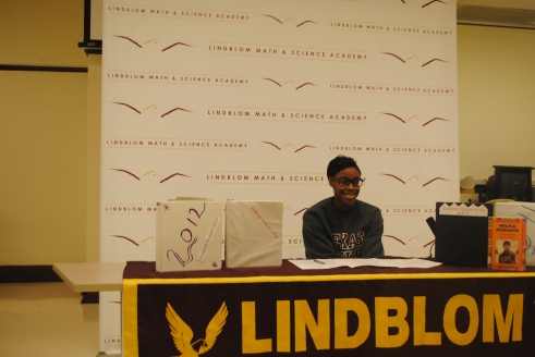 Alum Shamier Little signs her letter of intent to attend Texas A & M on Feb. 6, 2013 at Lindblom.